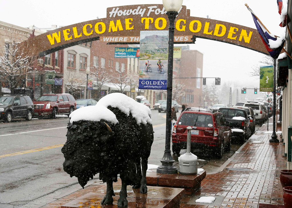 . A bison statue is covered with fresh snow in downtown Golden, Colorado May 1, 2013.    REUTERS/Rick Wilking