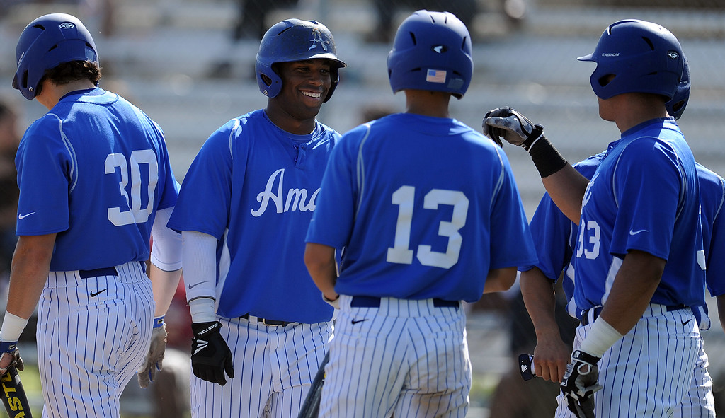 . Bishop Amat\'s Daryl Daniels, center, smiles after scoring in the third inning of a CIF-SS Division 3 first round playoff baseball game against Santiago at Bishop Amat High School on Wednesday, May 15, 2013 in La Puente, Calif. Bishop Amat won 12-3.  (Keith Birmingham Pasadena Star-News)