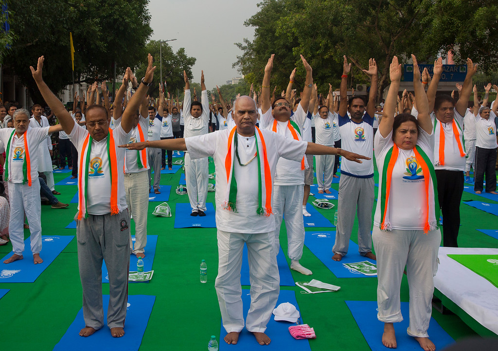 . Bihar Governor and Bharatiya Janata party candidate for the upcoming Presidential election next month Ram Nath Kovind, centre, performs yoga to mark the International Yoga Day in New Delhi, India, Wednesday, June 21, 2017. Millions of yoga enthusiasts across India take part in a mass yoga sessions to mark the third International Yoga Day which falls on June 21 every year. (AP Photo/Manish Swarup)