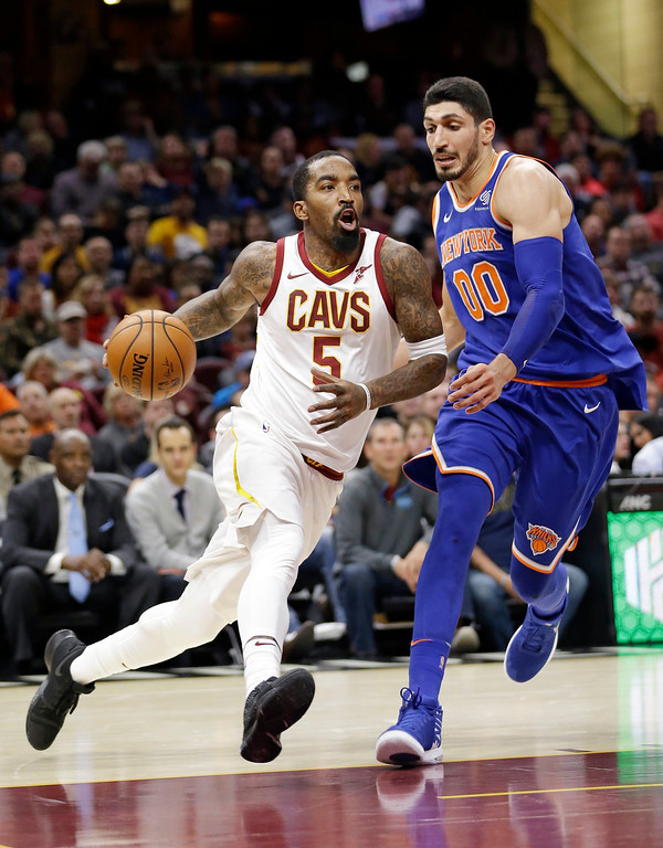 . Cleveland Cavaliers\' JR Smith (5) drives against New York Knicks\' Enes Kanter (00) in the first half of an NBA basketball game, Sunday, Oct. 29, 2017, in Cleveland. (AP Photo/Tony Dejak)