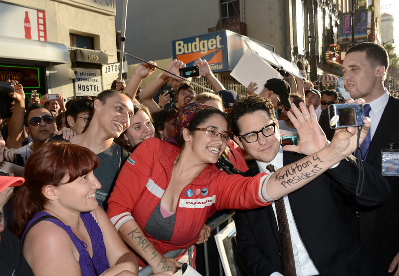 """. Director/Producer J.J. Abrams poses with fans as he arrives at the Premiere of Paramount Pictures\' \""""Star Trek Into Darkness\"""" at Dolby Theatre on May 14, 2013 in Hollywood, California.  (Photo by Kevin Winter/Getty Images for Paramount Pictures)"""