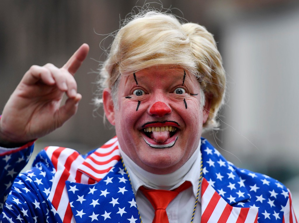 . A reveller dressed as U.S. president Donald Trump is pictured at the traditional carnival parade in Duesseldorf, Germany, on Monday, Feb. 27, 2017. The foolish street spectacles in the carnival centers of Duesseldorf, Mainz and Cologne, watched by hundreds of thousands of people, are the highlights in Germany\'s carnival season on Rose Monday. (AP Photo/Martin Meissner)