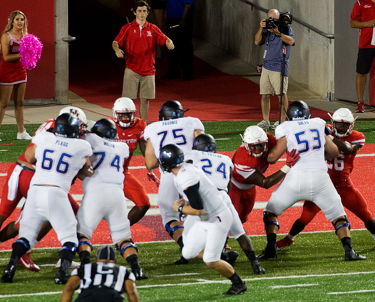 No. 24, Taylor, punches in a Tulsa touchdown.