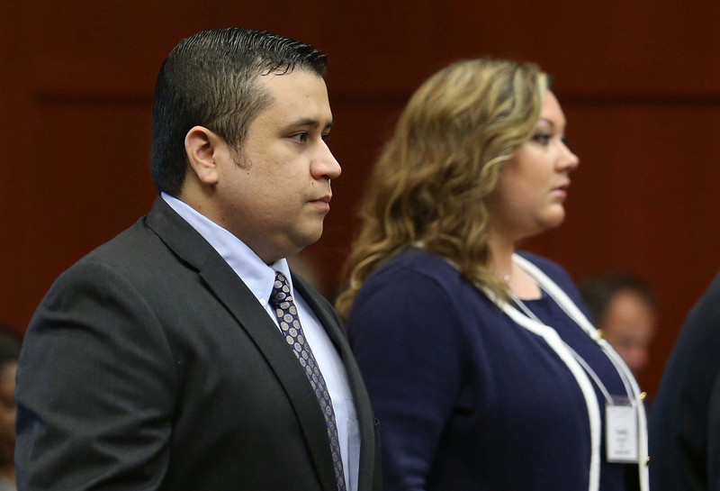 . George Zimmerman arrives with his wife Shellie, on the 11th day of his trial in Seminole circuit court June 24, 2013 in Sanford, Florida. Today prosecutors began with their opening statements. Zimmerman is charged with second-degree murder for the February 2012 shooting death of 17-year-old Trayvon Martin.  (Photo by Joe Burbank-Pool/Getty Images)