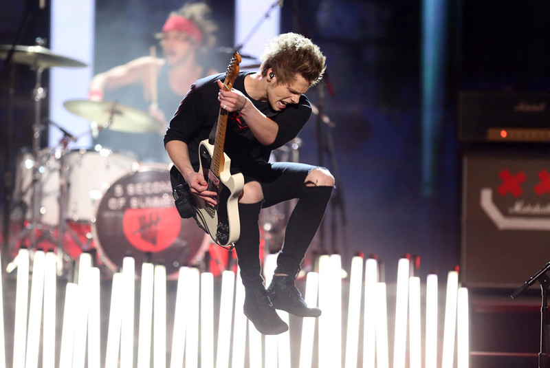 . Luke Hemmings of the group 5 Seconds of Summer performs on stage at the 42nd annual American Music Awards at Nokia Theatre L.A. Live on Sunday, Nov. 23, 2014, in Los Angeles. (Photo by Matt Sayles/Invision/AP)