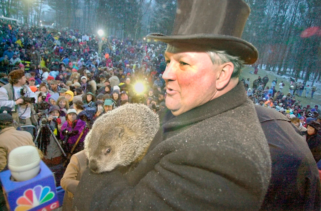 . FILE--Punxsutawney Phil, the weather prognosticating groundhog, is held on Gobbler\'s Knob on Feb. 2, 2001, by handler Bill Deeley, as thousands of  visitors to Punxsutawney, Pa., turn out to celebrate the mid-winter party. This year Feb. 2 falls on a Saturday for the first time in 13 years, and record crowds are expected. Police officials have volunteered to beef up security because this Groundhog Day falls on a Saturday and, to a lesser extent, because of the Sept. 11 terrorist attacks.(AP Photo/Gene J. Puskar, file)