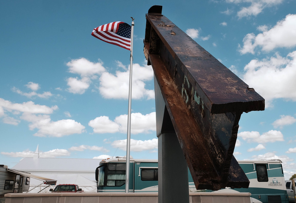 ". This Sept. 3, 2016 photo shows a beam from the destroyed World Trade Center buildings, part of the 9/11 Memorial near the Veterans\' Pavilion at the Fulton County Fair, in Wauseon, Ohio. �We just don�t know where the events of 9/11 have lead us,� said Rick Sluder, fire chief in Wauseon, Ohio, which obtained the beam and, together with neighboring departments built the memorial. ""A lot of people are looking at this as, is this point of downfall or the point at which we rose above the rest, the point of resiliency?� Sluder said. �I don�t think that�s been determined yet.� (Jetta Fraser/The Columbus Dispatch via AP)"