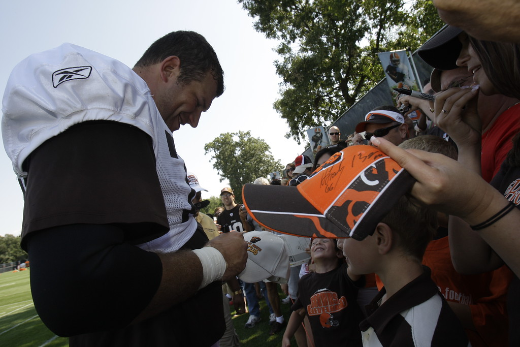 . Cleveland Browns offensive lineman Joe Thomas signs autographs at the Cleveland Browns NFL football training camp Sunday, Aug. 2, 2009, in Berea, Ohio. (AP Photo/Tony Dejak)
