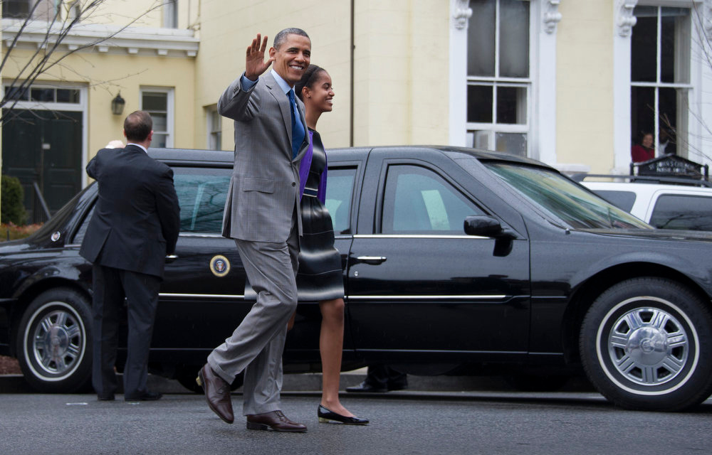Description of . US President Barack Obama and his daughter Malia depart St. John's Episcopal Church after Easter Sunday Services March 29, 2013 in Washington, DC.   AFP PHOTO/Jim WATSONJIM WATSON/AFP/Getty Images