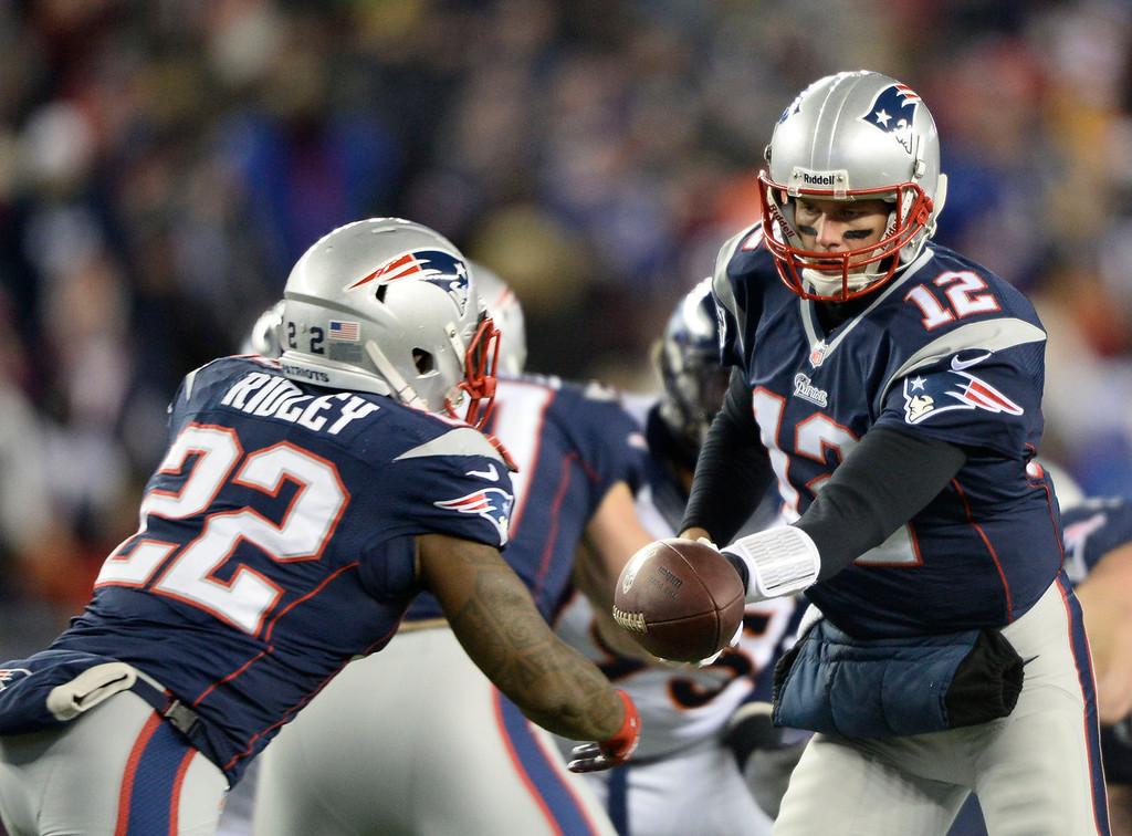 . New England Patriots quarterback Tom Brady (12) hands off to New England Patriots running back Stevan Ridley (22) during the first quarter agains the the Denver Broncos November 24, 2013 at Gillette Stadium. (Photo by John Leyba/The Denver Post)