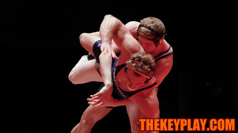 Jared Haught picks UVa's Zach Nye up off the ground. (Mark Umansky/TheKeyPlay.com)