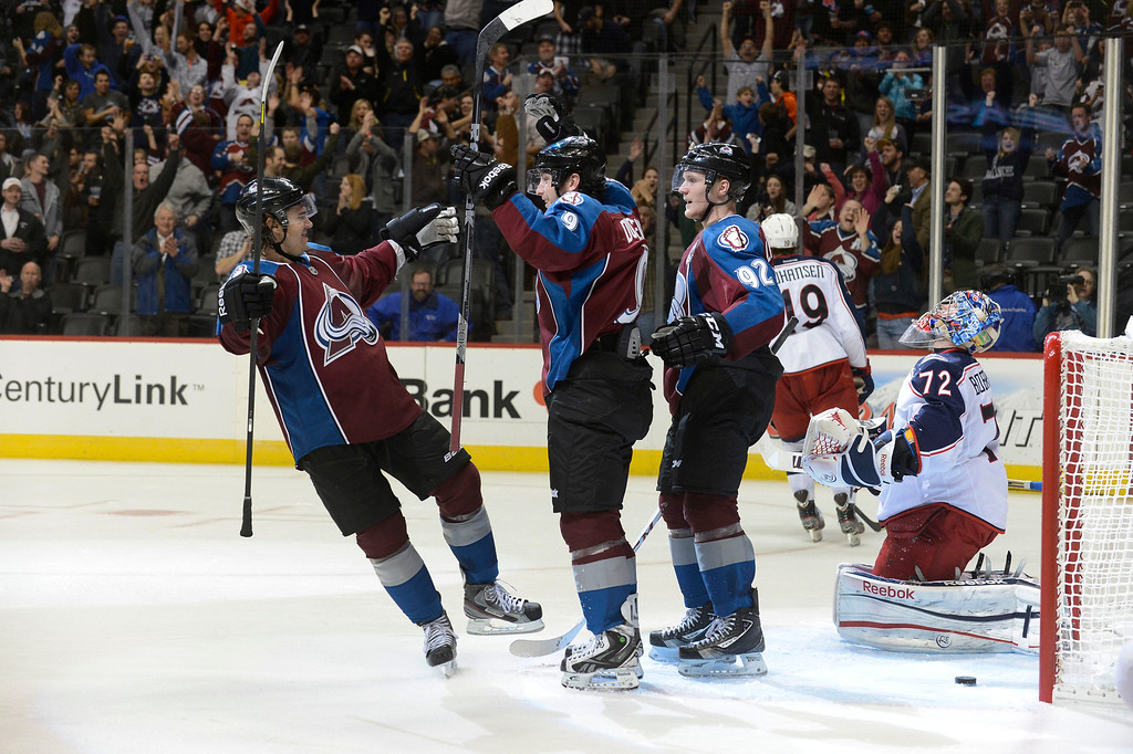 . DENVER, CO. - JANUARY 24: Colorado Avalanche center Matt Duchene (9) (center) celebrates his second goal of the night with Colorado Avalanche right wing P.A. Parenteau (15) and Colorado Avalanche left wing Gabriel Landeskog (92) during the third period January 24, 2013 at Pepsi Center. Columbus Blue Jackets goalie Sergei Bobrovsky (72) kneels defected i front of the goal. The Colorado Avalanche defeated the Columbus Blue Jackets 4-0.  (Photo By John Leyba / The Denver Post)