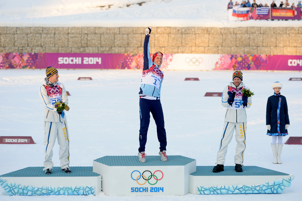 . (L-R) Silver medalist Teodor Peterson of Sweden, gold medalist Ola Vigen Hattestad of Norway and bronze medalist Emil Joensson of Sweden celebrate on the podium during the flower ceremony for the Finals of the Men\'s Sprint Free during day four of the Sochi 2014 Winter Olympics at Laura Cross-country Ski & Biathlon Center on February 11, 2014 in Sochi, Russia.  (Photo by Harry How/Getty Images)