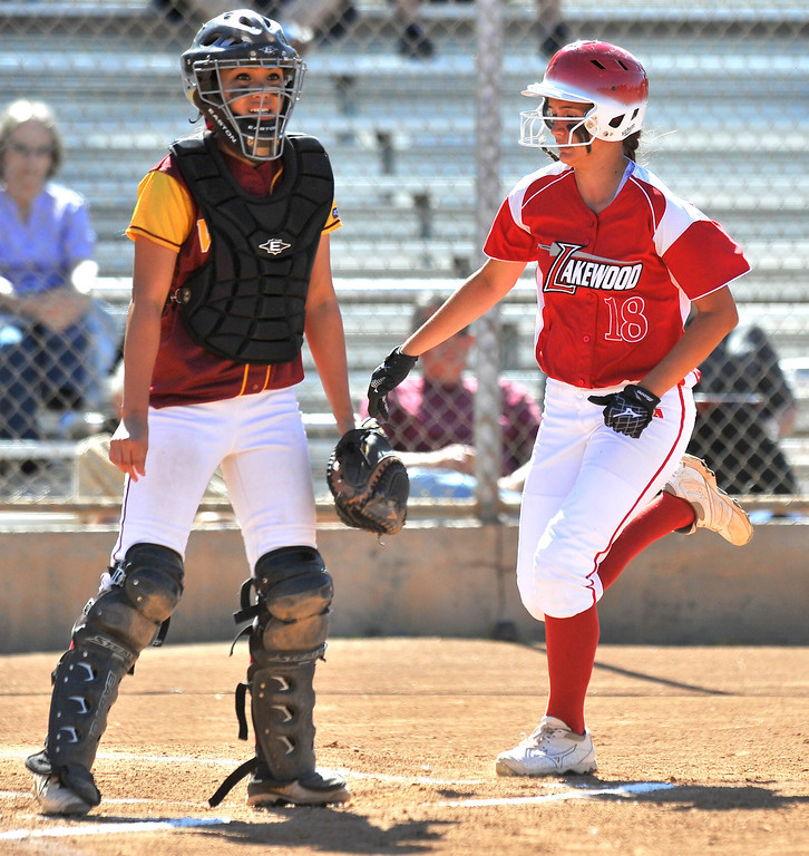 . LONG BEACH - 04/09/2013  (Photo: Scott Varley, Los Angeles Newspaper Group)  Lakewood vs Wilson girls softball at Joe Rodgers Field. Wilson catcher Alleah Laxamana waits for the throw as Lakewood\'s Montana Dixon scores on an inside the park 3-run homer.