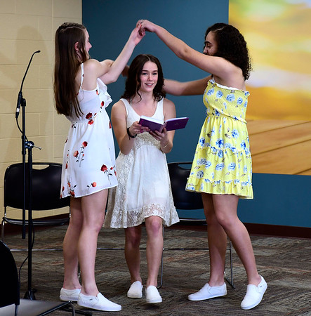 3/4/2020 Mike Orazzi | Staff New Britain High School Students, Isabella Petrisko, Sara Colapietro and Abby Olsen during a performance of Mamma Mia! at the New Britain Public Library on Wednesday night. The full show will be performed at New Britain High School on March 20 & 21st.
