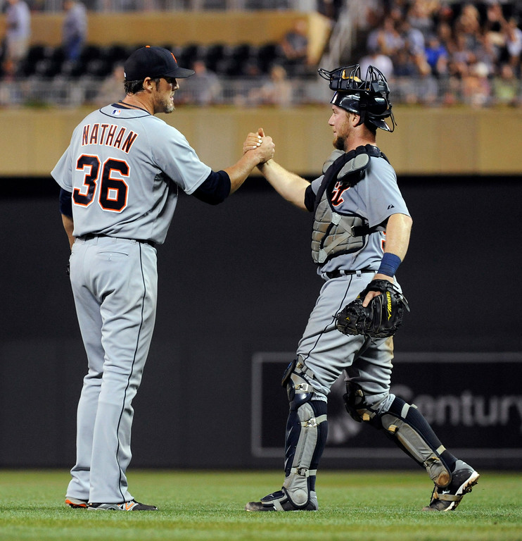 . Detroit Tigers pitcher Joe Nathan (36) celebrates with catcher Bryan Holaday after the Tigers defeated the Minnesota Twins 8-6 in a baseball game Saturday, Aug. 23, 2014, in Minneapolis. (AP Photo/Craig Lassig)