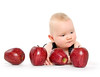 Baby boy playing with apples
