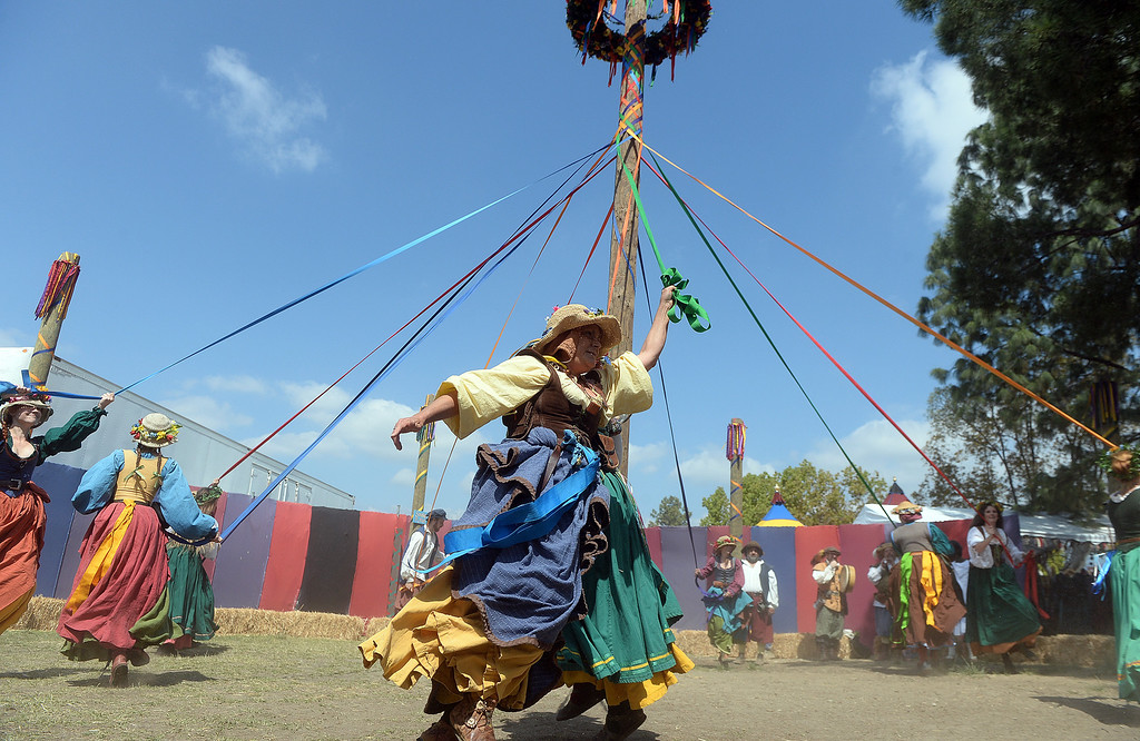 . Performers dance around the may pole on opening day of the Renaissance Pleasure Faire at Santa Fe Dam Recreation Area in Irwindale, Calif., on Saturday, April 5, 2014. 