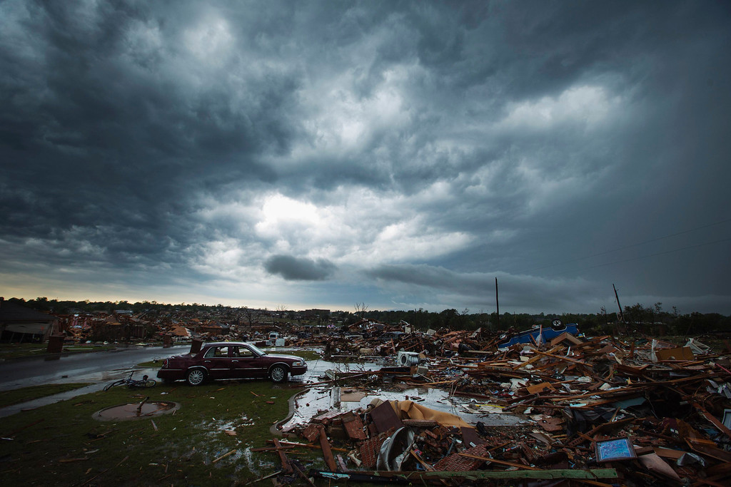 . The clouds of a thunderstorm roll over neighborhoods heavily damaged in a tornado in Moore, Oklahoma, May 23, 2013. REUTERS/Lucas Jackson