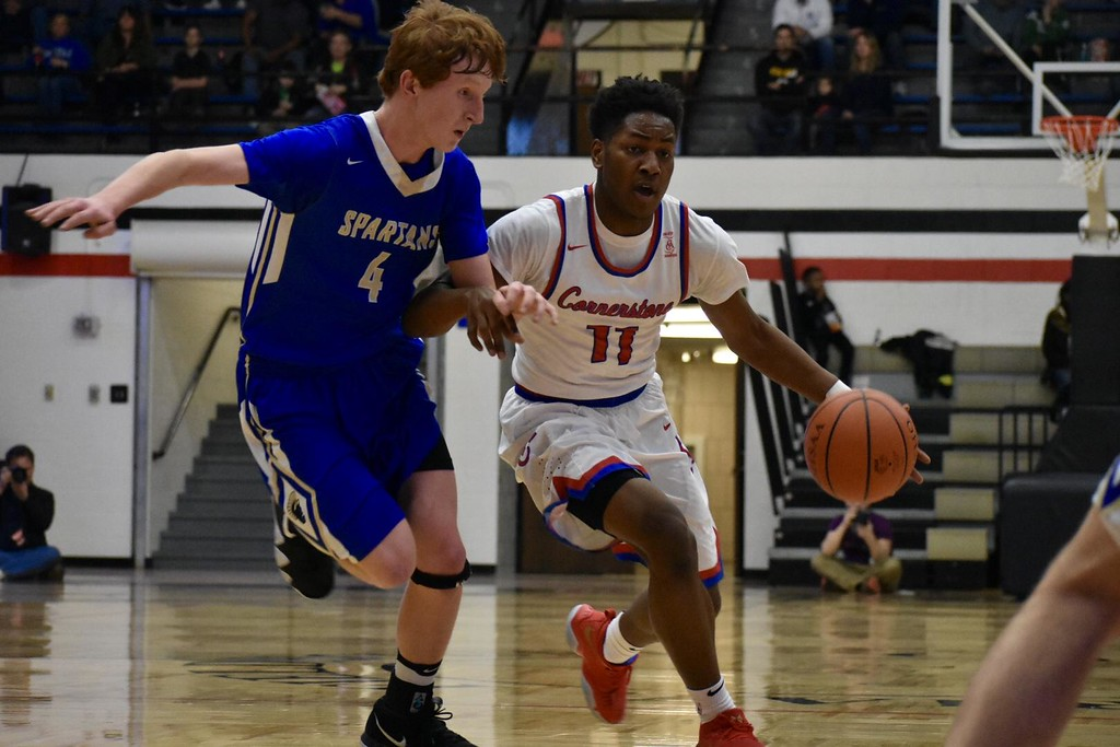 . DeAndre\' Patrick - The News-Herald Action from the Cornerstone Christian-Mansfield St. Peter\'s Division IV regional final March 16 in Canton.