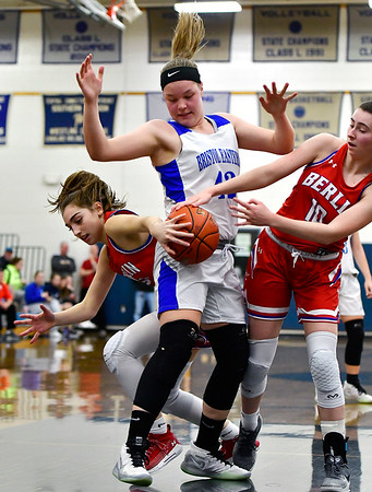 2/6/2020 Mike Orazzi | Staff Bristol Eastern's Avery Arbuckle (42) and Berlin's Clare McGeever (21) and Ashley Wenzel (10) at Bristol Eastern Thursday night.