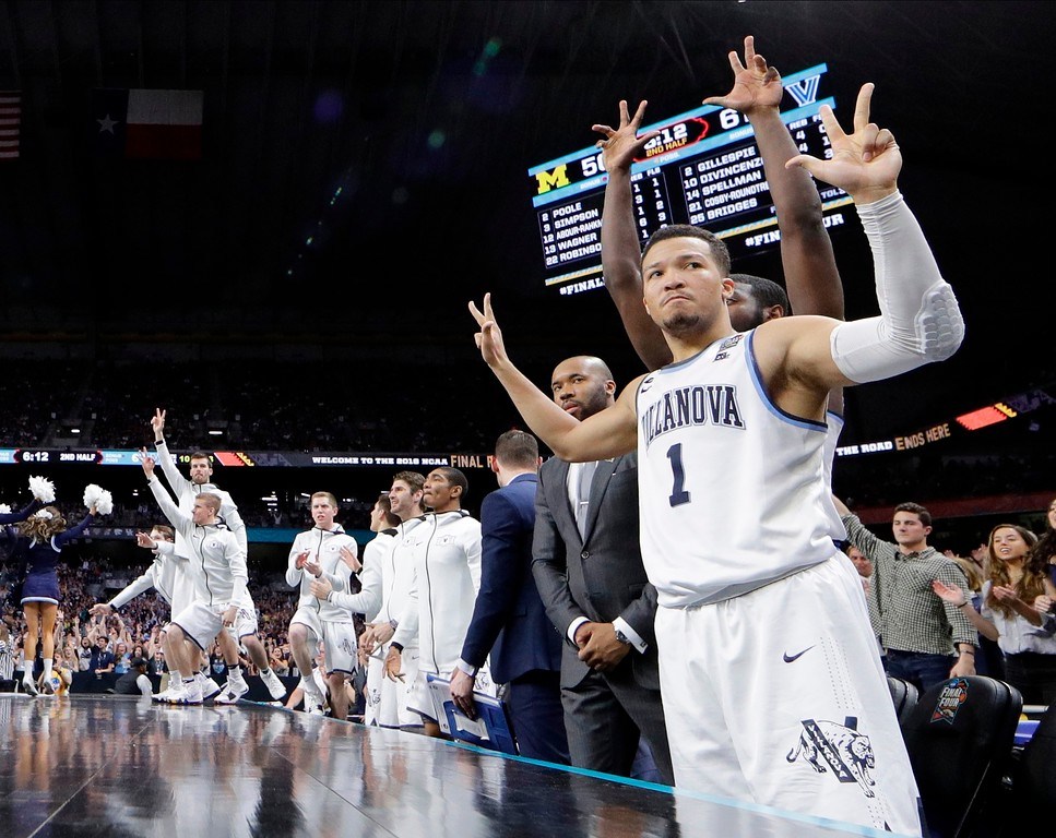 . Villanova\'s Jalen Brunson (1) and players on Villanova bench react to a 3-point basket during the second half in the championship game of the Final Four NCAA college basketball tournament against Michigan, Monday, April 2, 2018, in San Antonio. (AP Photo/David J. Phillip)