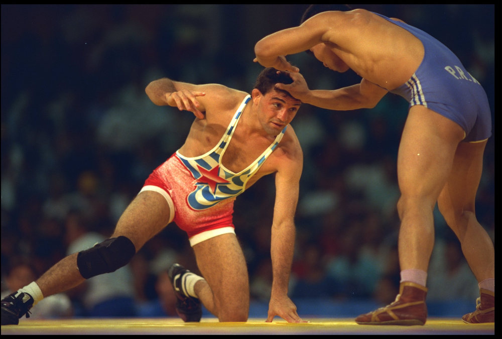 Description of . 5 AUG 1992:  JOHN SMITH OF THE UNITED STATES IS HELD DOWN BY KIM GWAGN CHOI OF NORTH KOREA DURING THEIR FEATHERWEIGHT FREESTYLE WRESTLING MATCH AT THE 1992 BARCELONA OLYMPICS. SMITH WENT ON TO WIN THE BOUT AND PROCEED TO THE NEXT ROUND. (Joe Tyler/The Denver Post)