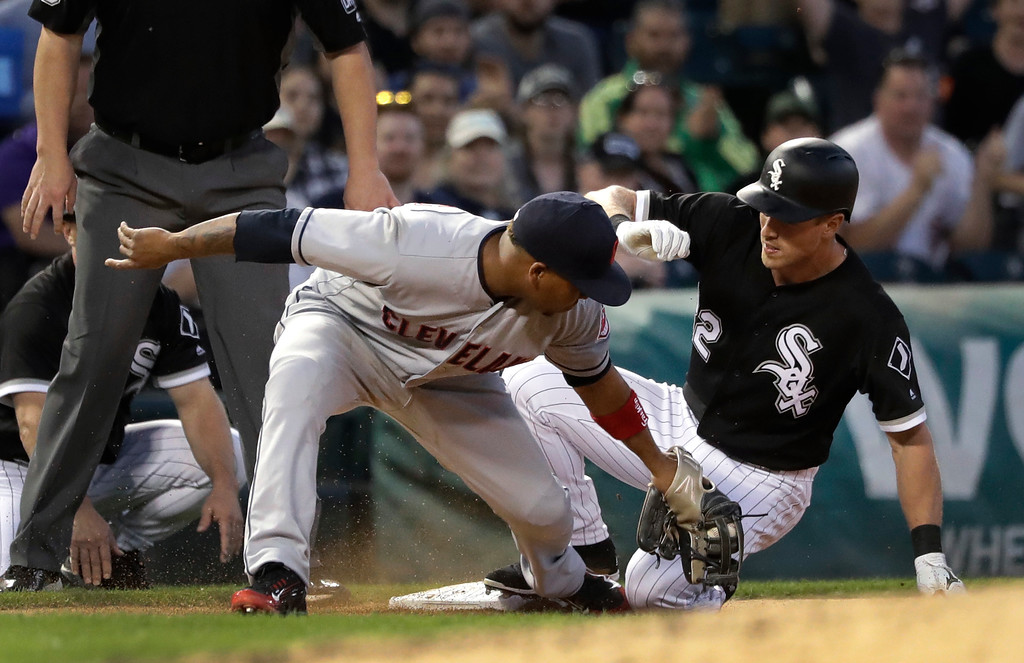 . Chicago White Sox\'s Charlie Tilson, right, slides into third behind Cleveland Indians\' Jose Ramirez on an RBI triple during the fifth inning of a baseball game Wednesday, June 13, 2018, in Chicago. Tim Anderson scored on the play. (AP Photo/Charles Rex Arbogast)