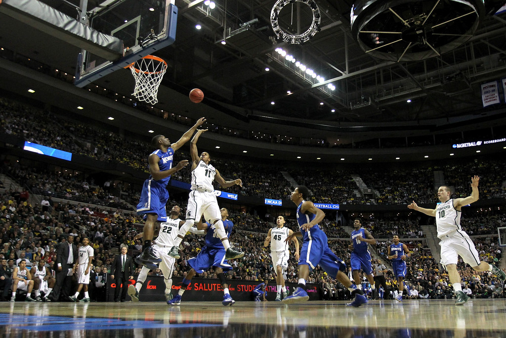 . AUBURN HILLS, MI - MARCH 23:  Keith Appling #11 of the Michigan State Spartans drives for a shot attempt against the Memphis Tigers during the third round of the 2013 NCAA Men\'s Basketball Tournament at The Palace of Auburn Hills on March 23, 2013 in Auburn Hills, Michigan.  (Photo by Jonathan Daniel/Getty Images)