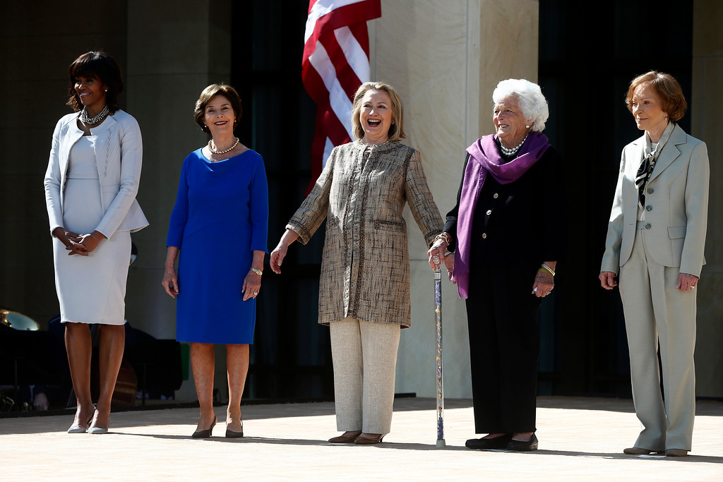 . First lady Michelle Obama, left, stands with, from second from left, former first ladies: Laura Bush; Hillary Rodham Clinton; Barbara Bush; and Rosalynn Carter; at the dedication of the George W. Bush presidential library on the campus of Southern Methodist University in Dallas, Thursday, April 25, 2013. (AP Photo/Charles Dharapak)