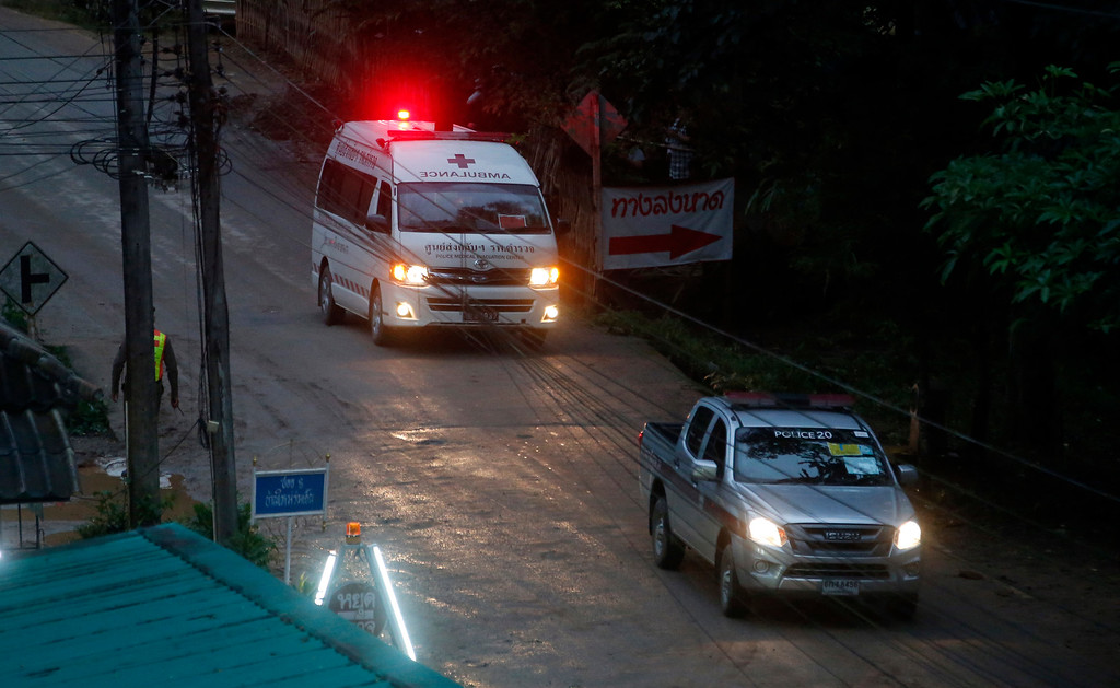 . One of two ambulances leave the cave in northern Thailand hours after operation began to rescue the trapped youth soccer players and their coach, in Mae Sai, Chiang Rai province, in northern Thailand, Sunday, July 8, 2018.  Chiang Rai province acting Gov. Narongsak Osatanakorn, who is heading the operation, said earlier Sunday that 13 foreign and five Thai divers were taking part in the rescue and two divers will accompany each boy as they\'re gradually extracted. He said the operation began at 10 a.m., and it will take at least 11 hours for the first person to be taken out of the cave. (AP Photo/Sakchai Lalit)