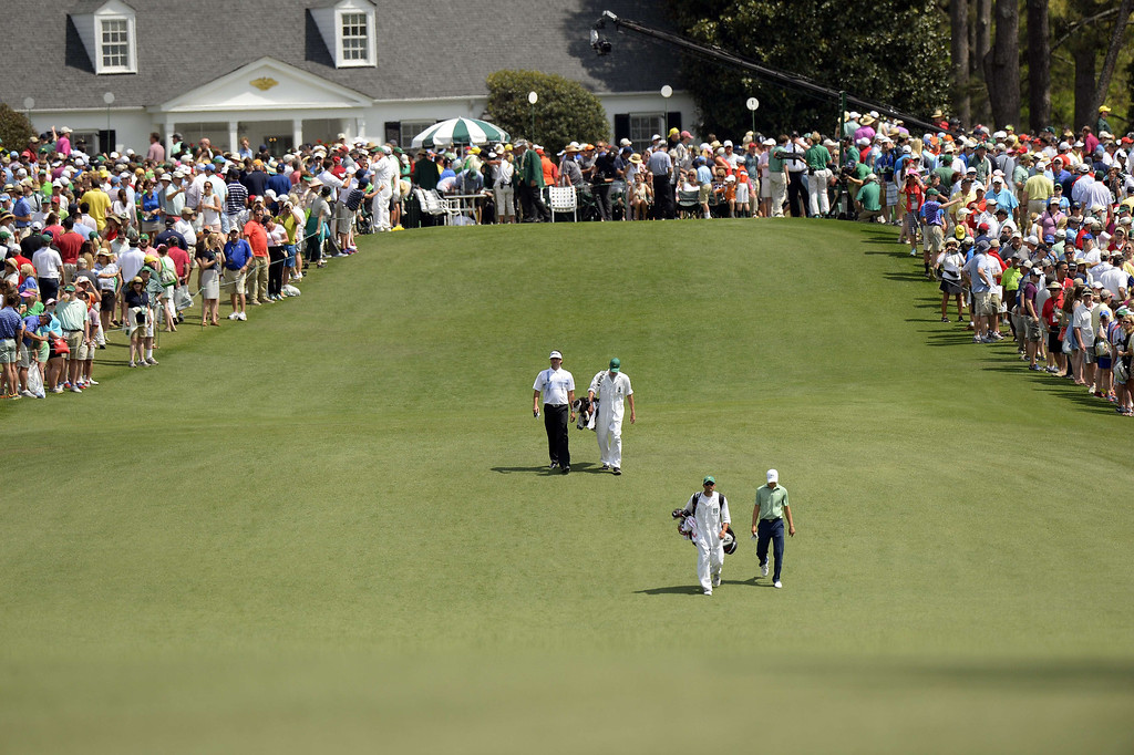 . Jordan Spieth (front) and Bubba Watson of the US walk on the first fairway during the final round of the 78th Masters Golf Tournament at Augusta National Golf Club on April 13, 2014 in Augusta, Georgia.     TIMOTHY A. CLARY/AFP/Getty Images