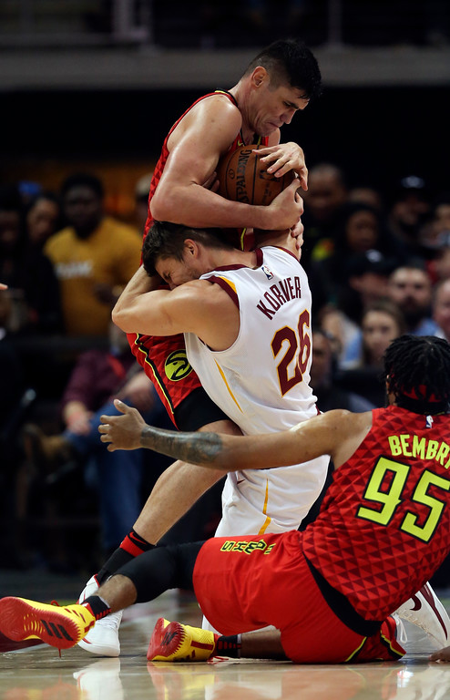 . Atlanta Hawks forward Ersan Ilyasova (7) and Cleveland Cavaliers guard Kyle Korver (26) battle for the ball in the second half of an NBA basketball game Thursday, Nov. 30, 2017, in Atlanta. Cleveland won 121-114. (AP Photo/John Bazemore)