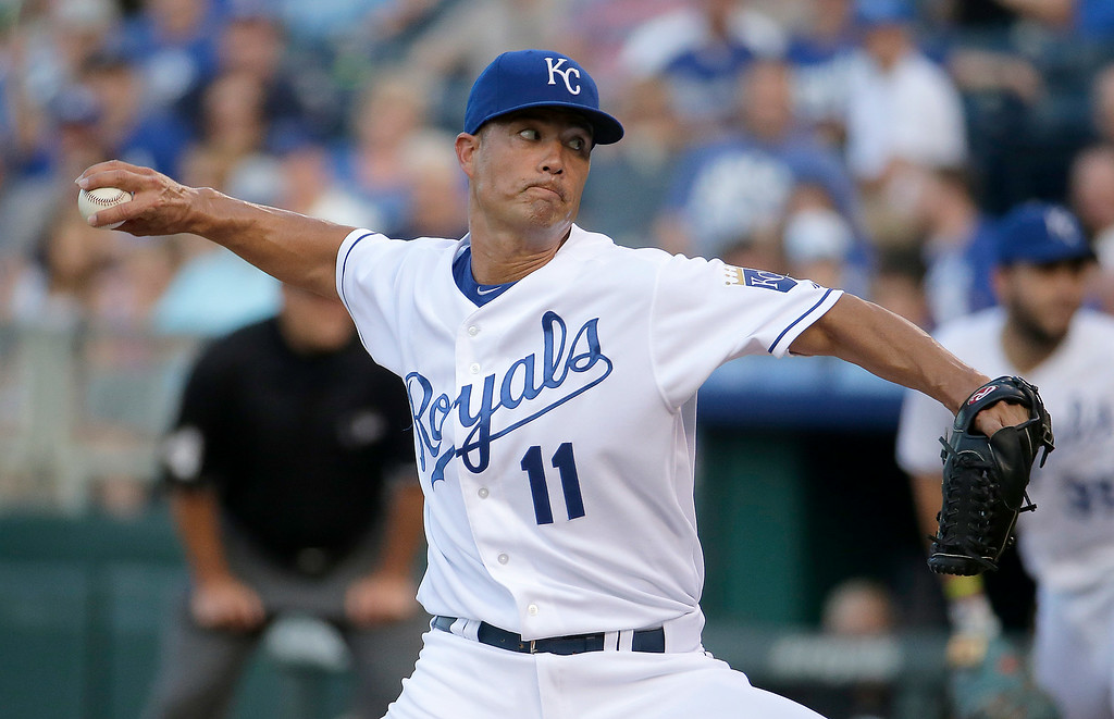 . Kansas City Royals starting pitcher Jeremy Guthrie throws during the first inning of a baseball game against the Detroit Tigers Thursday, July 10, 2014, in Kansas City, Mo. (AP Photo/Charlie Riedel)