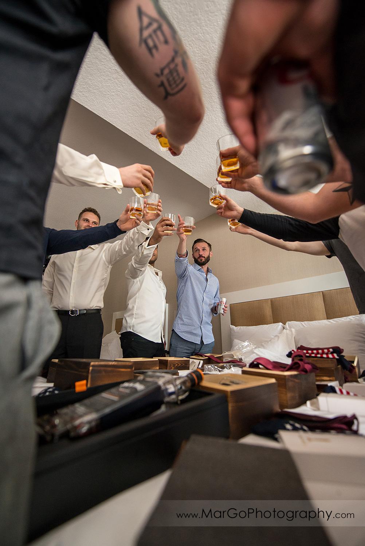 groom and groomsmen drinking whiskey at San Diego Hyatt Regency Mission Bay Hotel