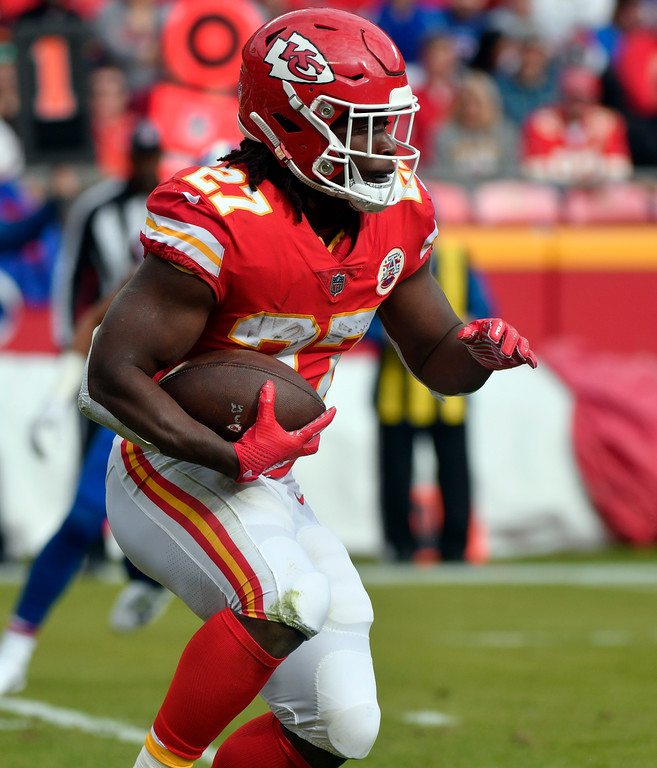 . Kansas City Chiefs running back Kareem Hunt (27) carries the ball during the first half of an NFL football game against the Buffalo Bills in Kansas City, Mo., Sunday, Nov. 26, 2017. (AP Photo/Ed Zurga)