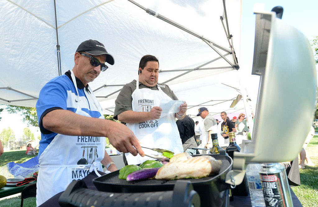 ". Chef Bill Reneti Massimo, left, with Fremont\'s Massimo\'s restaurant and Fremont Mayor Bill Harrison, prepare meals during the ""Alameda County Mayors\' Healthy Cook-Off Challenge\"" held at the Dublin Farmers\' Market at Emerald Glen Park in Dublin, Calif., on Thursday, July 25, 2013. The winners advanced to compete against the winners of the Contra Cost County Mayors\' Healthy Cook-Off Challenge. The contest will be held at Mt. Diablo High School in the fall. The cook-off was presented by Concord\'s Wellness City Challenge and promotes the importance of healthy eating. (Doug Duran/Bay Area News Group)"