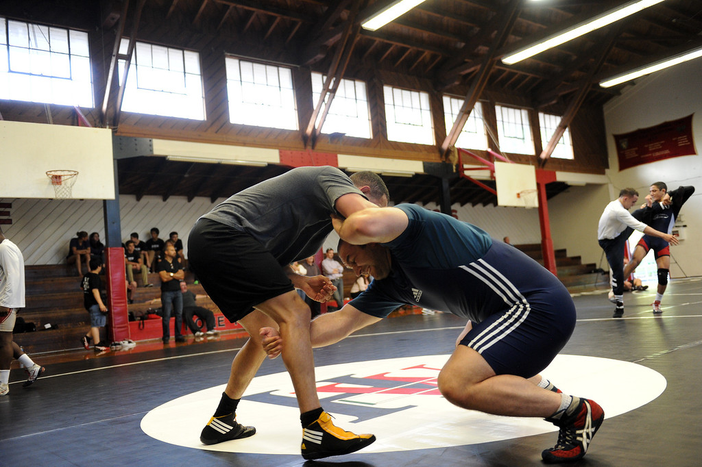 . The U.S. national wrestling team members Chris Pendleton, left, and Tervel Dlagnev practice at Harvard-Westlake High School, Friday, May 17, 2013. The USA, Canada and Russia national teams will meet for in exhibition 2:00 p.m. Sunday at L.A. Memorial Sports Arena. (Michael Owen Baker/Staff Photographer)