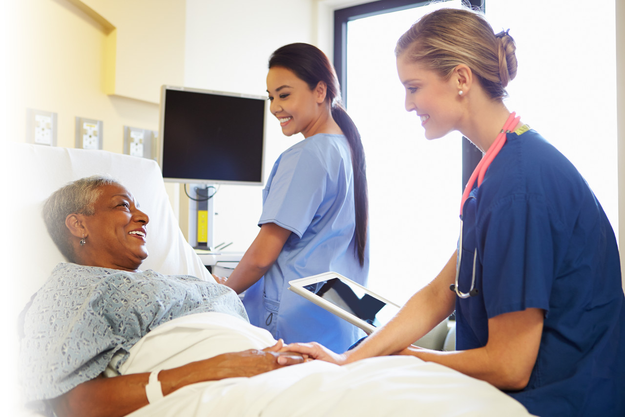 //www.dreamstime.com/stock-photo-nurse-digital-tablet-talks-to-woman-hospital-bed-smiling-each-other-reassuring-patient-image35795000