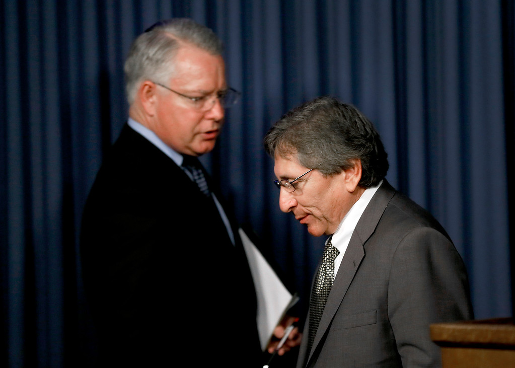 . Maricopa County Attorney Bill Montgomery, left, approaches the podium as county prosecutor Juan Martinez steps down during a news conference to discuss the outcome of the Jodi Arias sentencing retrial, Thursday, March 5, 2015, in Phoenix. A judge declared a mistrial Thursday in the Arias sentencing retrial after a jury deadlocked on whether the convicted murderer should be executed or sent to prison for life for the 2008 killing of Travis Alexander.(AP Photo/Matt York)