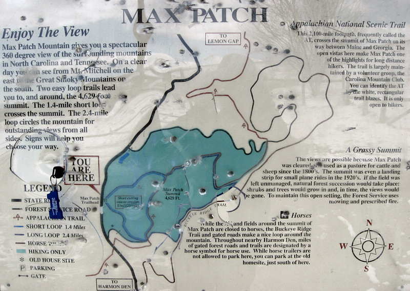 """The bullet-ridden parking lot trail map (apparently the locals are a bit violent)...I'd be following the so-called """"Long Loop"""" with a side trip over the summit for a total of about 3-miles..."""
