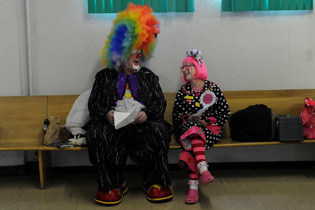 . Tiny, aka Doug Kelley, left, and Fuchsia Pinkleman, aka Karen Gross, laugh as they rehearse the line for their skit before Clown Class at First Presbyterian Church in Englewood on Sunday, March 3, 2013. The Colorado Clowns presented the 10-week series of classes that taught participants how to apply make up, character development, skits, parades and the history of clowning. Seth A. McConnell, YourHub