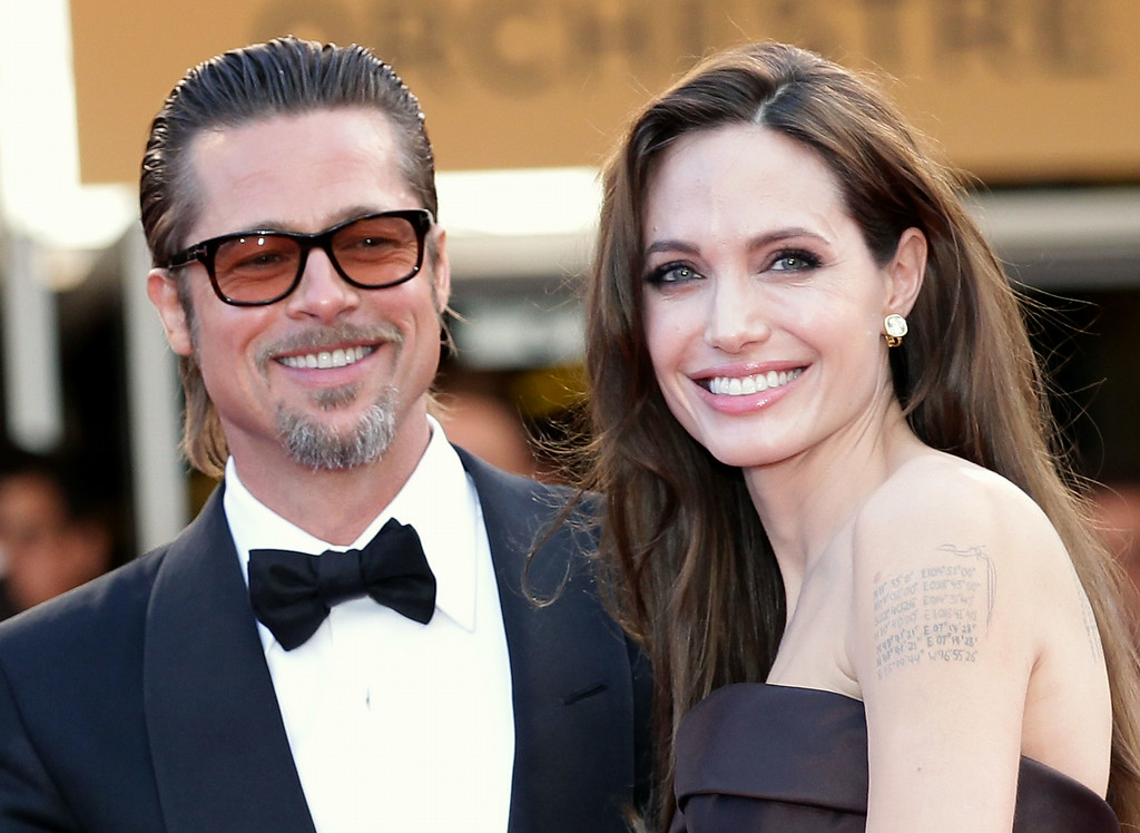 ". Angelina Jolie (R) and Brad Pitt attend ""The Tree Of Life\"" premiere during the 64th Annual Cannes Film Festival at Palais des Festivals on May 16, 2011 in Cannes, France.  (Photo by Andreas Rentz/Getty Images)"