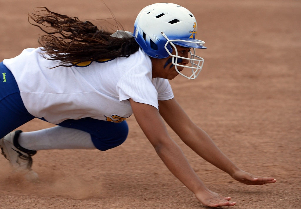 . Bishop Amat\'s Sofia Venegas moves to third base on a single by Amanda Sanchez (C) (not pictured) in the first inning of a prep playoff softball game against La Serna at Bishop Amat High School in La Puente, Calif., on Thursday, May 22, 2014. La Serna won 6-0.   (Keith Birmingham/Pasadena Star-News)