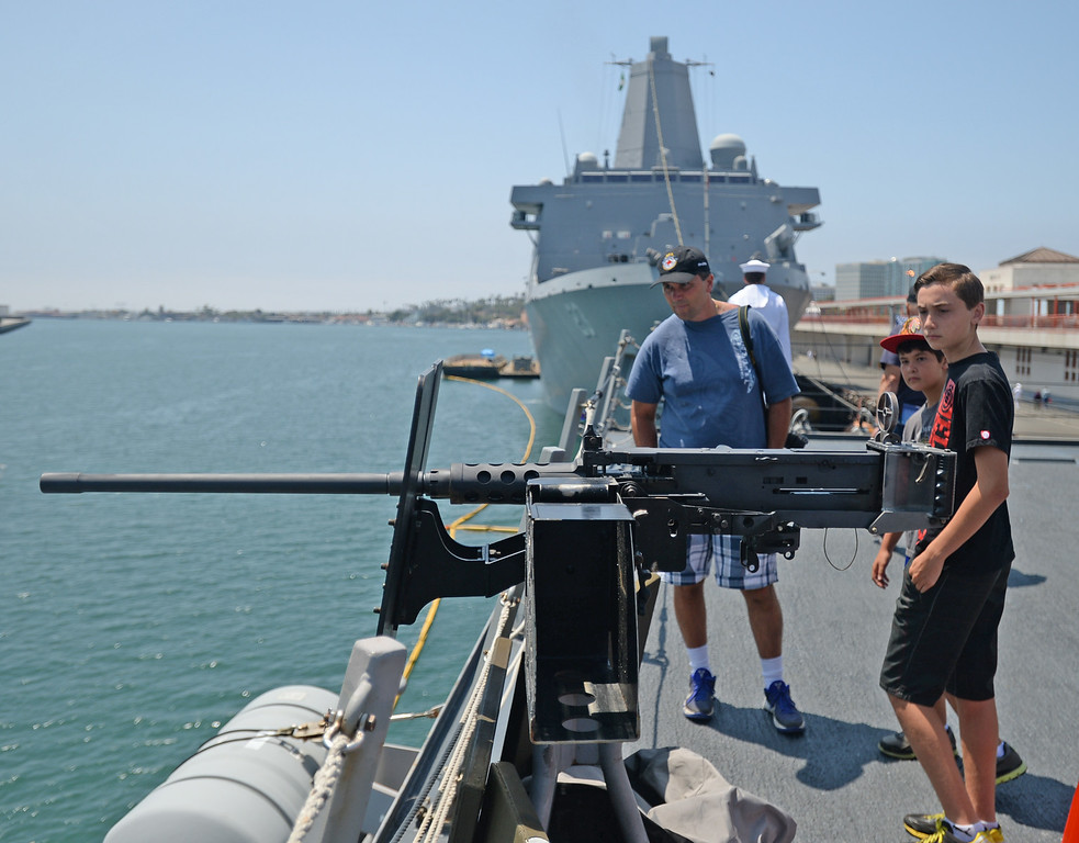 . People take a tour of the USS Spruance, an Arleigh Burke-class guided missile destroyer, which is docked in the Port of Los Angeles for Navy Days.  50 caliber machine guns are used for defense against small craft attacks. The USS Anchorage, in background, is also docked for Navy Days. Saturday, August 09, 2014, San Pedro, CA.   Photo by Steve McCrank/Daily Breeze