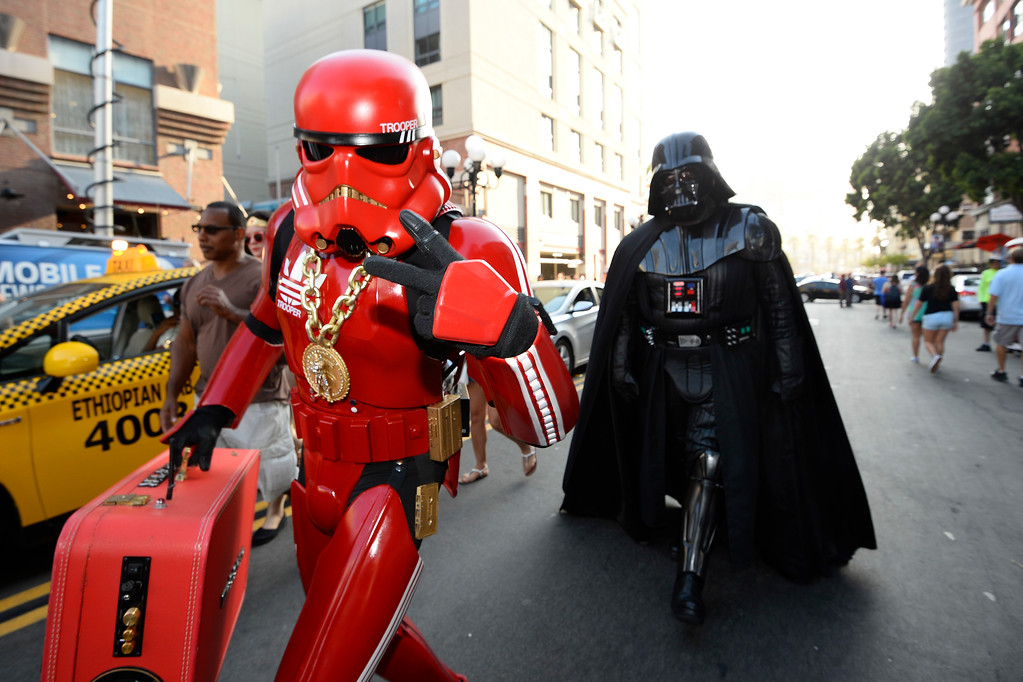 . Fans dressed in Star War\'s themed costumes walk down the street on day three of the Comic-Con International held at the San Diego Convention Center Saturday July 23, 2016 in San Diego.  (Photo by Denis Poroy/Invision/AP)