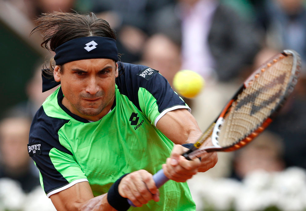 . Spain\'s David Ferrer returns the ball to compatriot Rafael Nadal during the men\'s  final match of the French Open tennis tournament at the Roland Garros stadium Sunday, June 9, 2013 in Paris. (AP Photo/Petr David Josek)