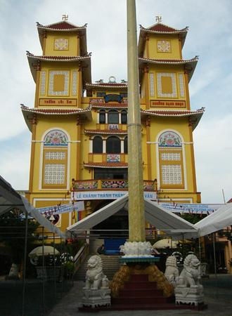 The curious Cao Dai sect's neighborhood temple in Saigon.