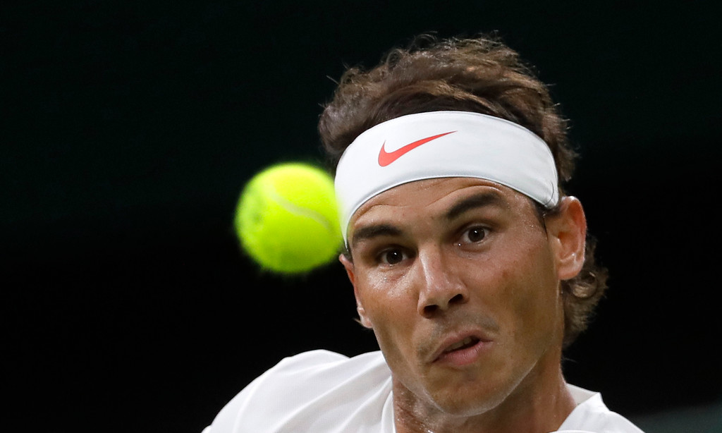 . Rafael Nadal of Spain returns the ball to Serbia\'s Novak Djokovic during their men\'s singles semifinals match at the Wimbledon Tennis Championships, in London, Friday July 13, 2018.(AP Photo/Kirsty Wigglesworth)