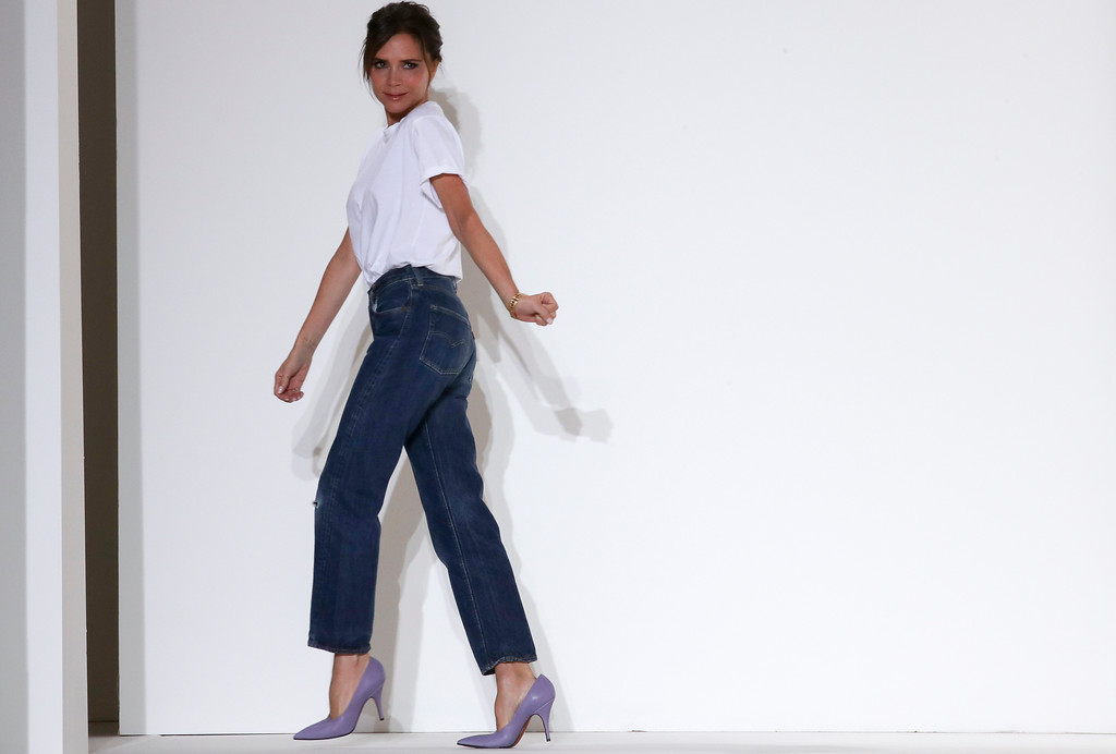 . Victoria Beckham acknowledges the audience at the end of her Spring/Summer 2018 fashion show during New York Fashion Week, Sunday, Sept. 10, 2017. (AP Photo/Mary Altaffer)